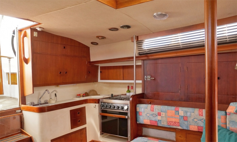 Galley, adjacent to the 2 step companionway, well ventilated, everything in reach