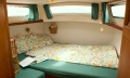Owner's cabin with comfortable double berth, slatted frame and 8' mattress, private hatch