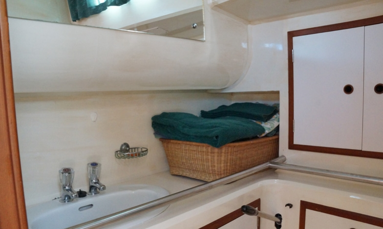 Aft cabin bathroom with ample storage space, full headroom