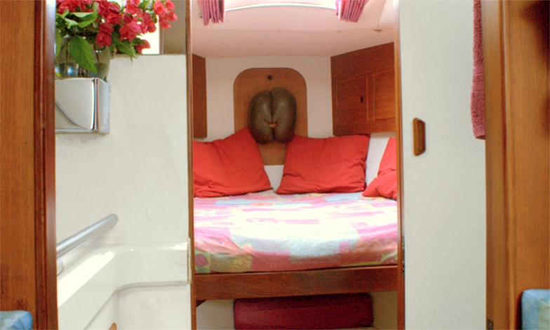 Guests' cabin, double berth with inset or separated, private hatch, multiple storage cabinets